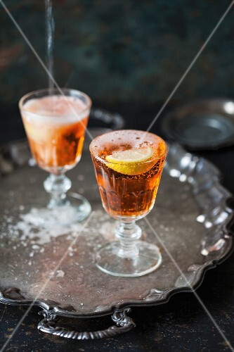 Two glasses of Aperol Spritz on a tray
