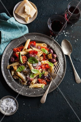 Penne with roasted aubergines, peppers and basil