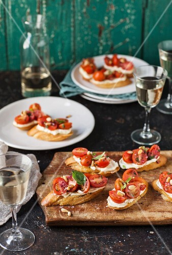 Bruschetta with tomatoes, whipped goat cheese and pine nuts