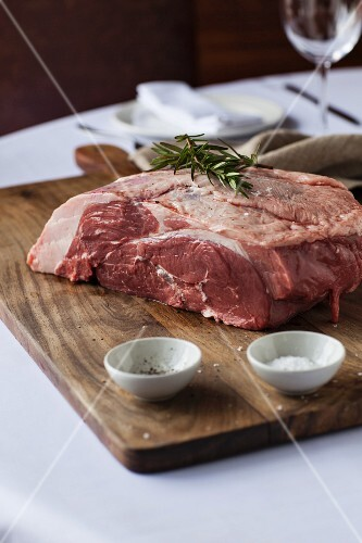 Raw lamb with salt and rosemary