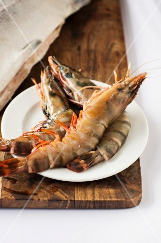 Raw king prawns on a plate