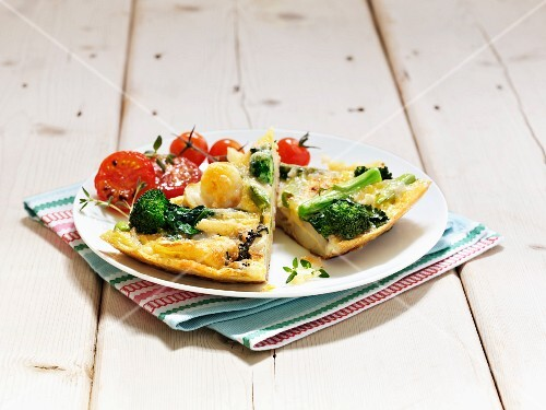Two slices of potato tortilla with broccoli