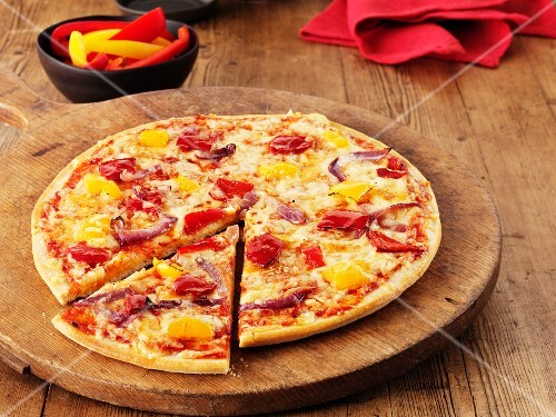 Vegetable pizza with peppers, sliced