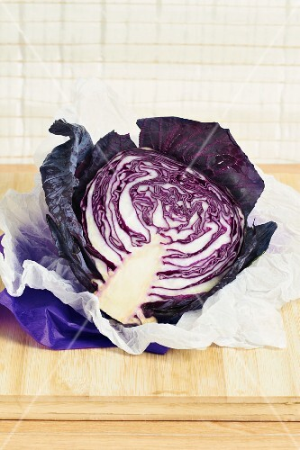 Half a red cabbage on a piece of white paper