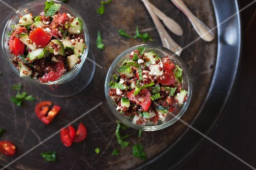 Salad with red quinoa, tomatoes, cucumber, feta cheese and mint