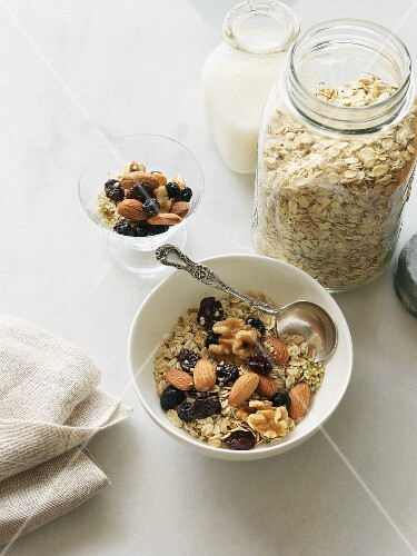 Breakfast cereal with almonds, walnuts, dried cherries, hemp seeds and milk