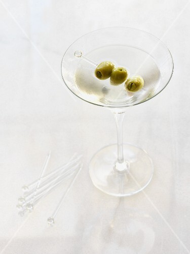 A dry Martini with an olive skewer
