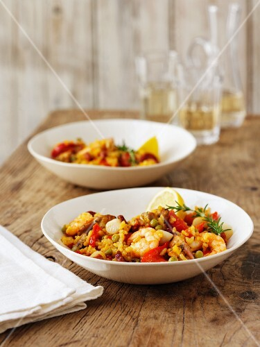 Seafood paella with lemon and rosemary