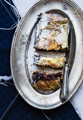 Plum and chocolate strudel on a silver plate