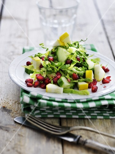 Mixed leaf salad with courgette, cucumber and pomegranate seeds