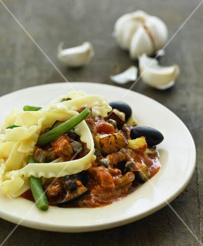 Mafaldine with a vegetable ragout and olives