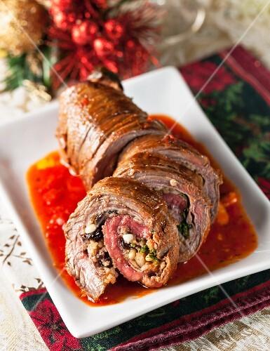 Beef roulade with garlic, bread crumbs, ham, raisins, walnuts and romano cheese (Christmas)