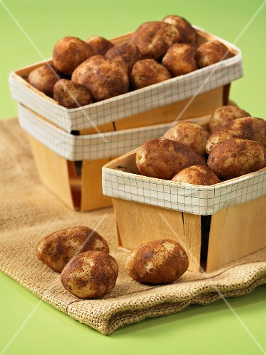 Marzipan potatoes in wooden baskets