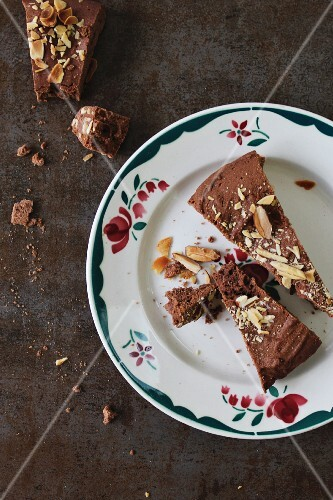 Slices of chocolate cake with almonds