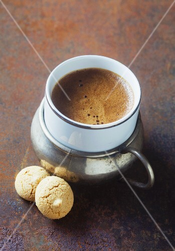 An espresso in an oriental cup on a metal surface