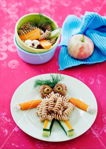 Pasta, meatballs and vegetables on a plate
