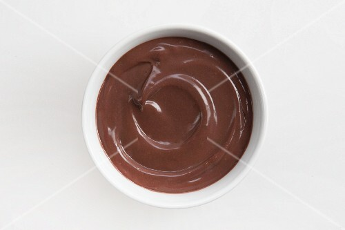 Chocolate pudding in white bowl