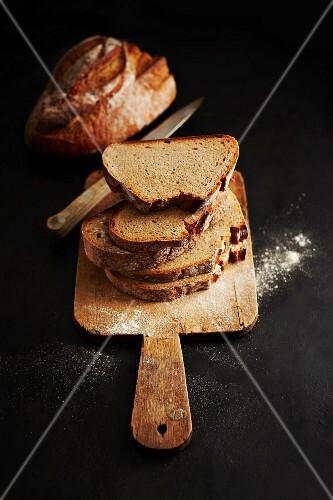 Sliced bread on a wooden board