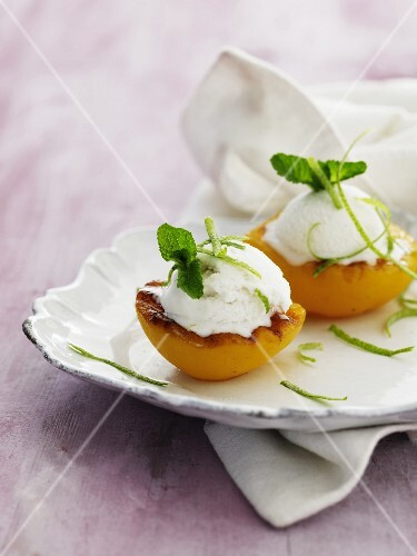 Grilled peaches with ice cream, lime zest and lemon balm
