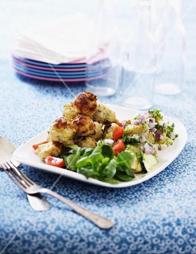 Fish balls with a potato and lamb's lettuce salad