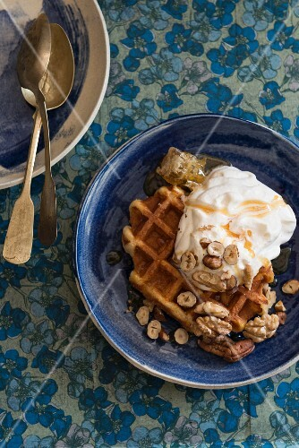 Waffles with honey, cream and nuts