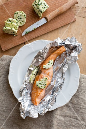 Salmon with herb butter in aluminium foil