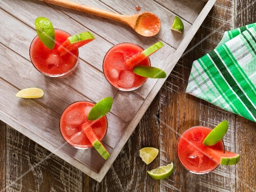 Watermelon cocktails on a rustic wooden tray