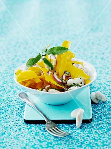 Thinly sliced mango with white beans, onions and sage