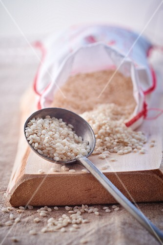 Short-grain rice in a sack and on a spoon