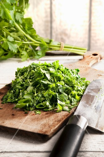 Chopped parsley on a wooden board