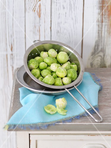 Brussels sprouts in metal colander