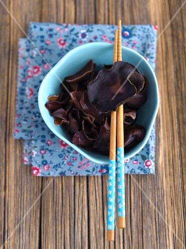 Jelly ear fungus in a bowl with chopsticks