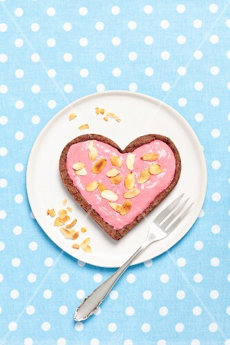 A heart-shaped chocolate tart with raspberry mousse