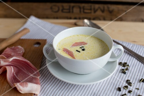 Celery soup with ham and pumpkin seeds