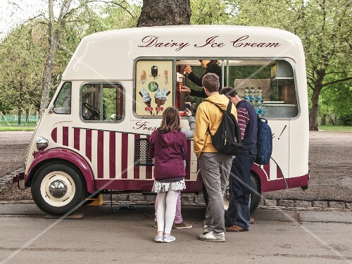 An ice cream van in a park in London, England