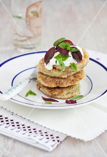 Fried green tomatoes with cornflour, yogurt and fresh herbs