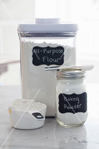 Containers of flour and baking powder