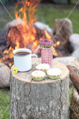 Muffins and tea by a campfire