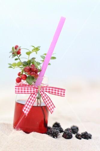 Fruit juice on a beach