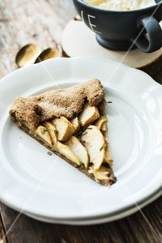 A slice of apple galette with rosemary