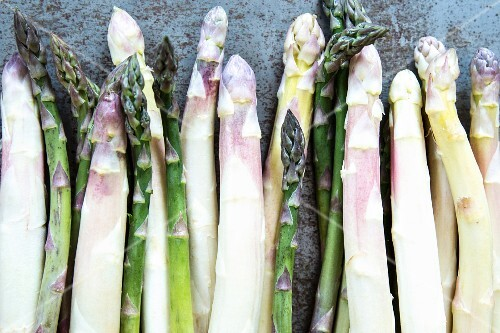 Rows of green and white asparagus