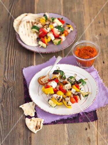 Turkey breast and vegetable skewers with ajvar and unleavened bread