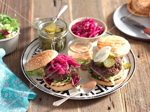 Beef burgers with caramelised onions and gherkins