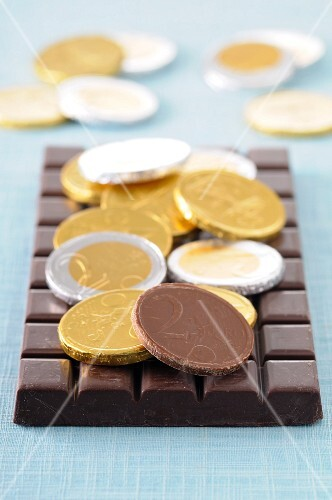 Chocolate coins and a bar of chocolate