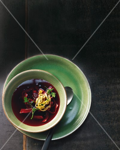 Beetroot and lemongrass broth with herb pancakes