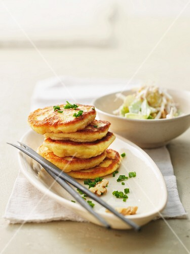 Potato pancakes with celery and grape salad