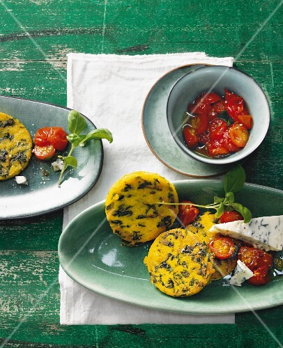 Fried spinach polenta with oven-roasted tomatoes and gorgonzola