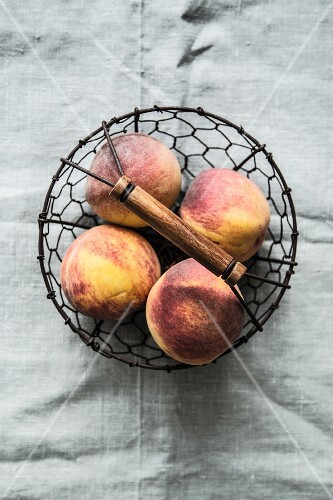 Peaches in a wire basket