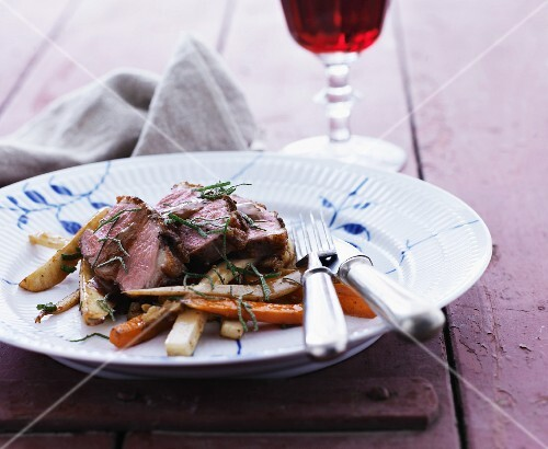 Duck breast on a bed of roasted root vegetables