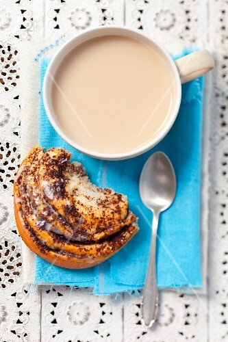 A poppyseed pastry with a cafe au lait